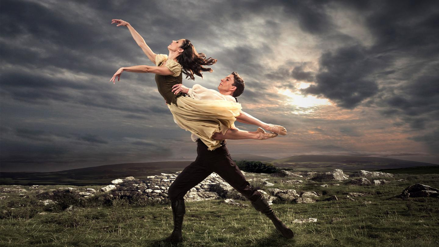 Heathcliff lifts Cathy on the moors on our poster for Wuthering Heights.