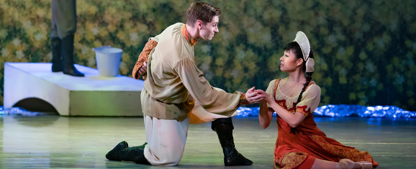 Ashley Dixon's Father holds the hand of Miki Akuta's Young Cinderella to lift her out of her sadness. Photo Emma Kauldhar.