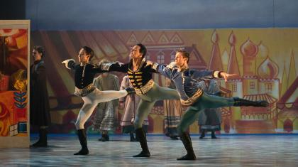 Northern Ballet dancers Riku Ito, Javier Torres and Nicola Gervasi dancing with joy in Cinderella. Photo Emma Kauldhar.