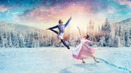 The Nutcracker Prince jumps high and Clara reaches up to catch him