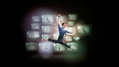 Poster photo for 1984 with Tobias Batley leaping in front of countless vintage televisions.