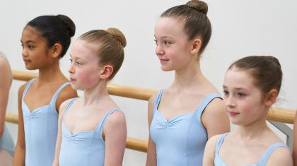 Ballet students stand in line