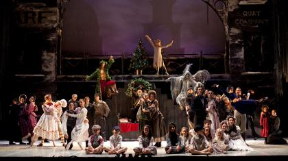 The full cast of A Christmas Carol gather on stage in the finalé